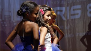 "Contestants walk on stage during the ""mini-miss"" beauty contest in Bobigny, Paris suburb"