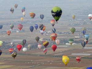 Hot air balloons float in the sky