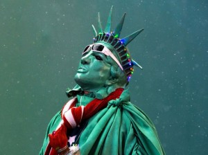 A street performer dressed as the Statue of Liberty stands amongst light snow in Times Square in New York